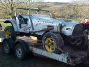 Off road buggy arriving on trailer